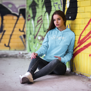 hoodie-mockup-featuring-a-woman-leaning-against-a-graffitied-wall-2797-el1.png