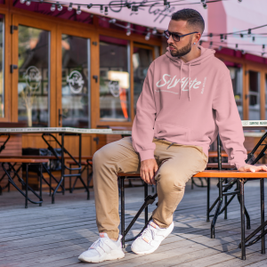 hoodie-mockup-of-a-serious-man-sitting-at-an-open-air-restaurant-2276-el1.png